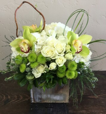 pink roses and bright green orchid blooms