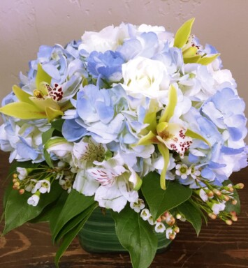 hydrangeas and orchids in a vase