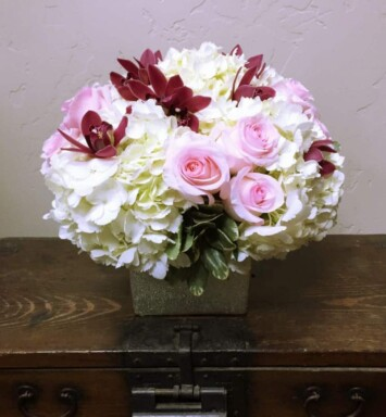 peonies and roses in a vase