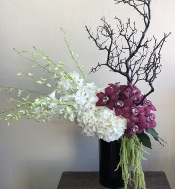 orchids and branch in vase