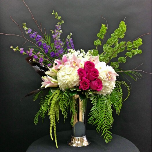 hydrangeas and roses in a large vase