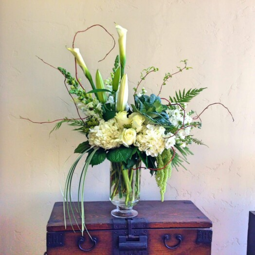 roses and calla lilies in a vase