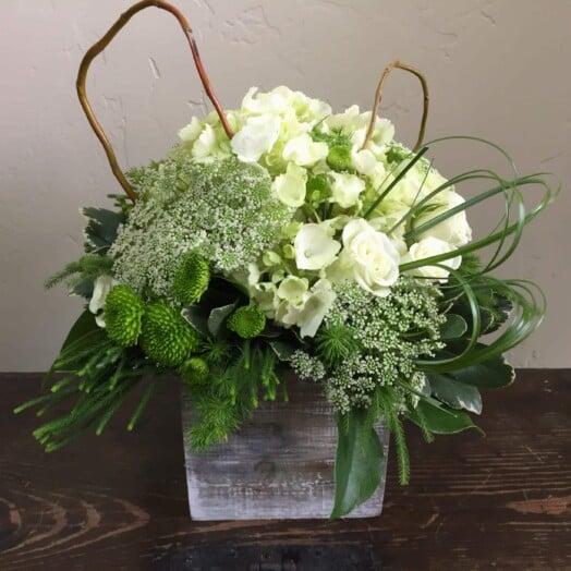 pretty flowers in wood vase