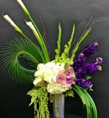 calla lilies hydrangeas and roses in a vase