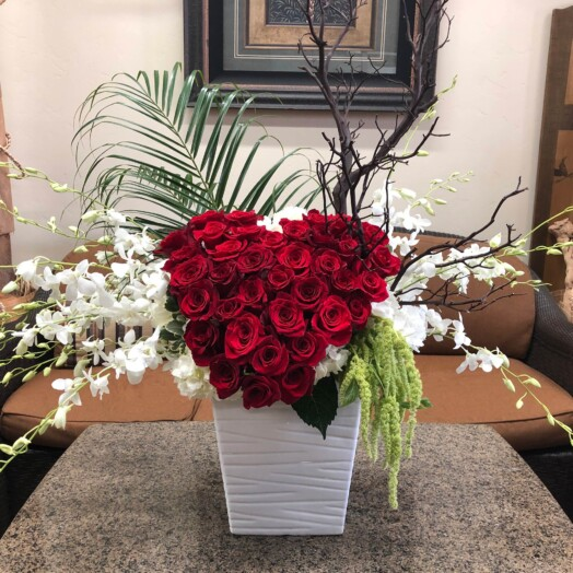 large red heart of roses with orchids