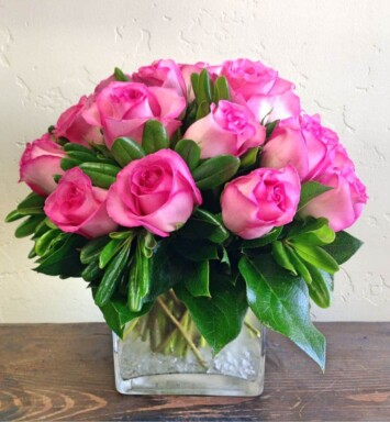 pink roses in a small vase