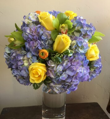 Ranunculus, roses and hydrangeas in a vase