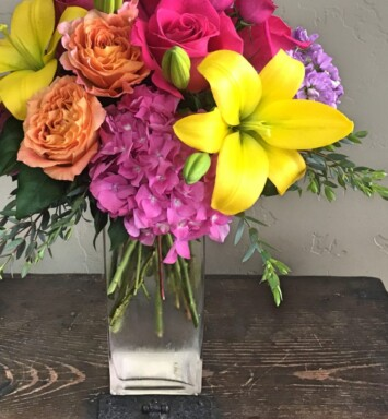 roses hydrangeas lilies in a vase