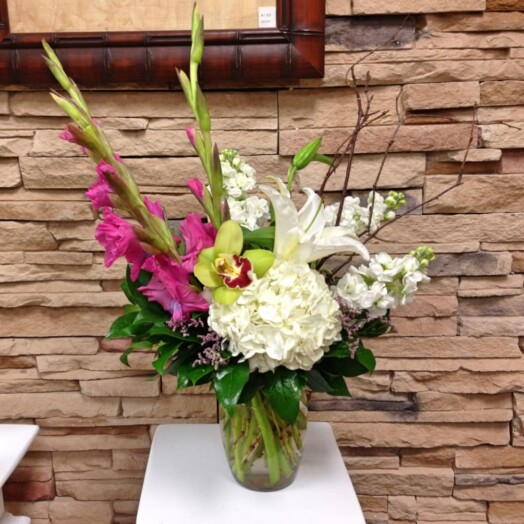 calla lilies, hydrangeas and orchids in vase