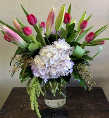 tulips, hydrangeas and lilies in a vase