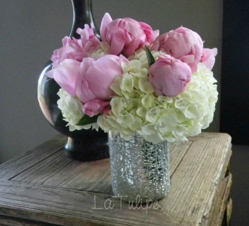 peonies and hydrangeas in a vase