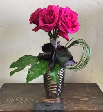 roses in a small vase