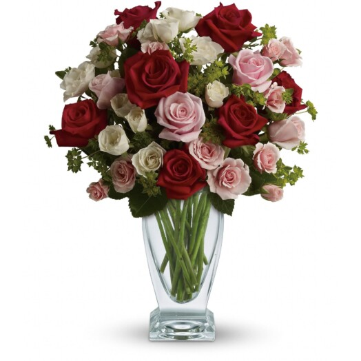 red pink white roses in a vase