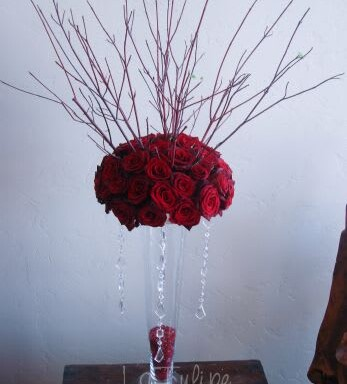 rede roses in a vase tall