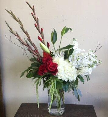 roses, hydrangeas and greens in a vase