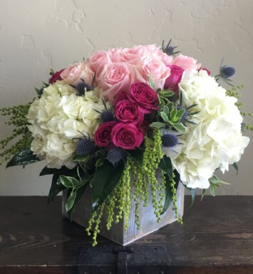 hydrangeas and roses in a vase
