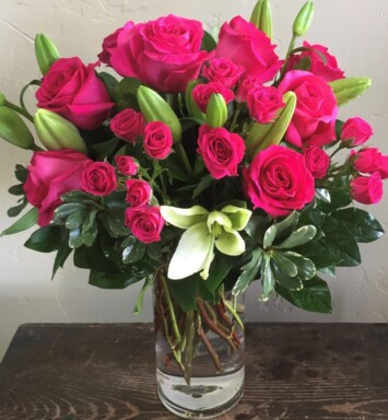 lilies and roses in a vase