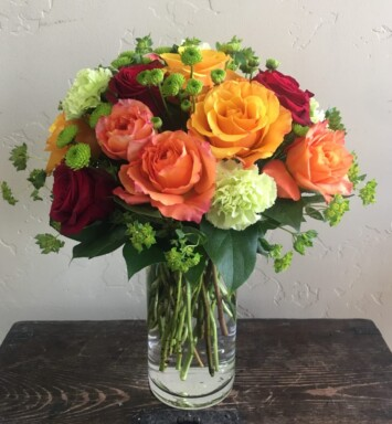 Roses of many colors in a vase