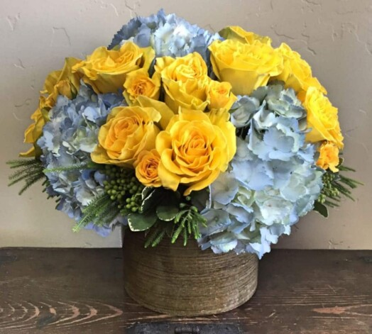 yellow and blue flowers in a vase
