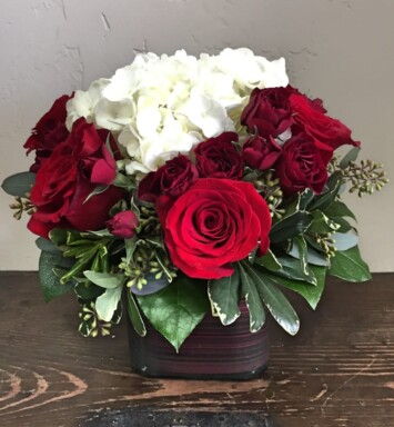 roses and hydrangeas in a vase