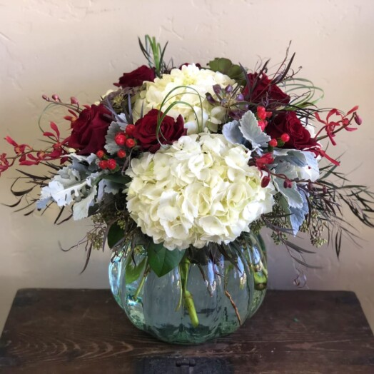 deep red roses and hydrangeas