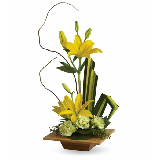 yellow asiatic lilies and green carnations accented with tropical greenery