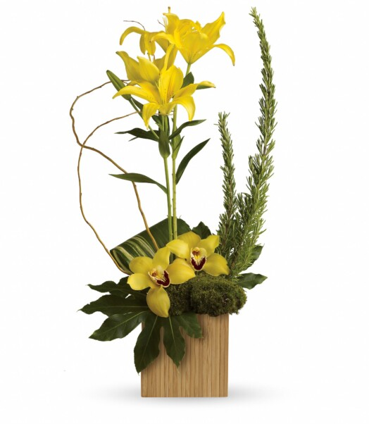 yellow lilies and orchids in bamboo