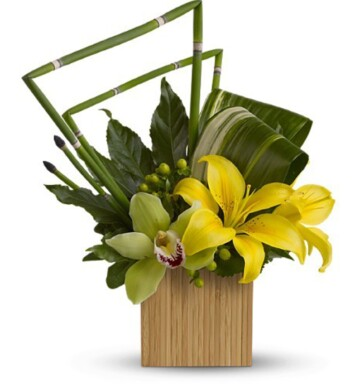 Asiatic lilies, green cymbidium orchids and green hypericum