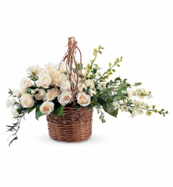 wicker basket filled with beautiful white flowers