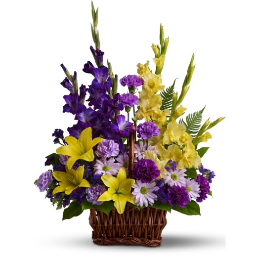 unique sympathy basket accents yellow lilies and purple gladioli with tropical greens and ferns