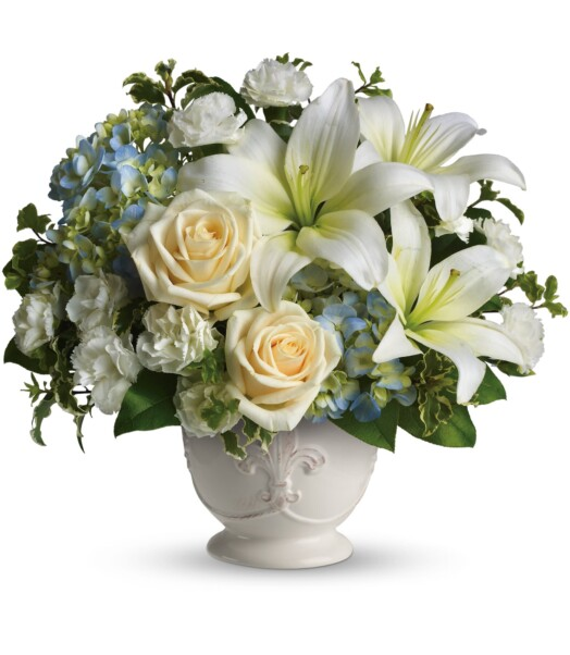 blue hydrangeas, crème roses, white miniature carnations, fragrant white asiatic lilies