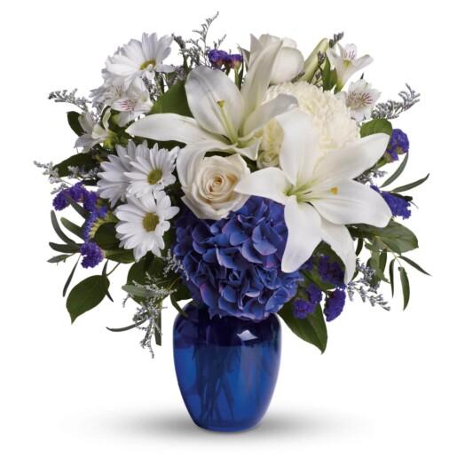 blue hydrangea, crème roses, graceful white oriental lilies, white alstroemeria