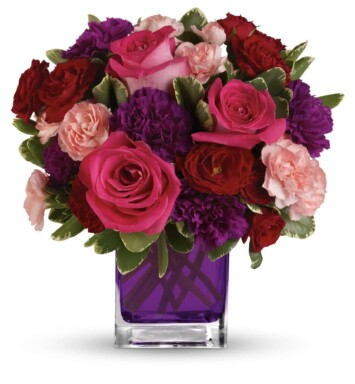 Hot pink roses, dark red spray roses, purple carnations and pink miniature carnations