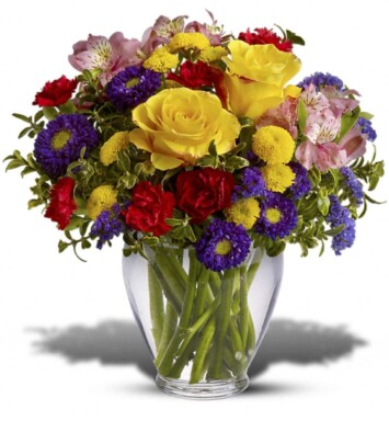 Roses, alstroemeria asters carnations and chrysanthemums in a vase