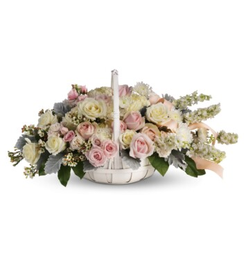 softly colored roses and chrysanthemums are nestled in a round white basket