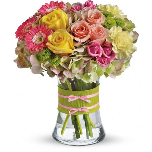 pink spray roses and mini gerberas, light yellow carnations in a vase