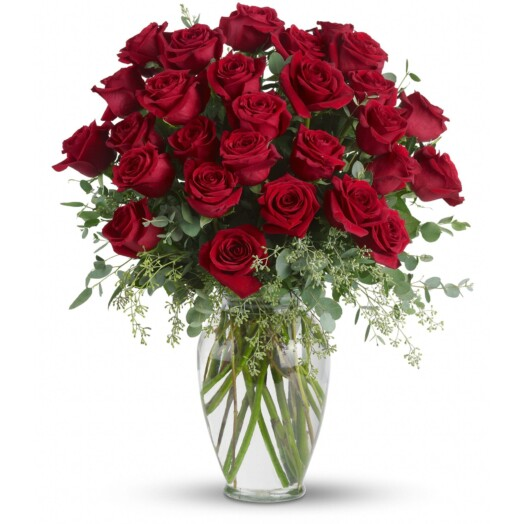 thirty red roses in a vase