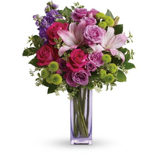green lavender and purple flowers in a vase