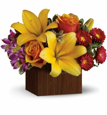 Yellow asiatic lilies, purple alstroemeria, orange roses