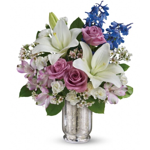 white blue and lavender flower in mercury vase