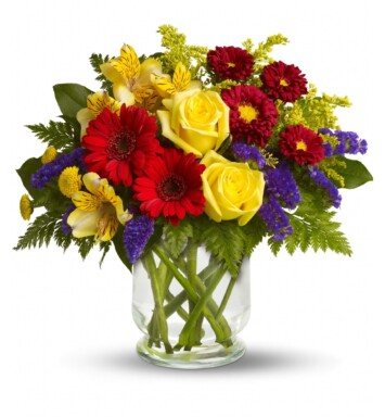 yellow roses and red carnations in a vase