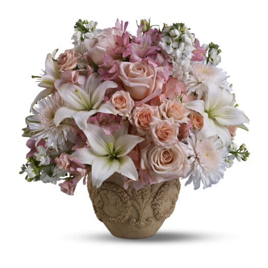 hydrangea, roses and alstroemeria are mixed with white flowers