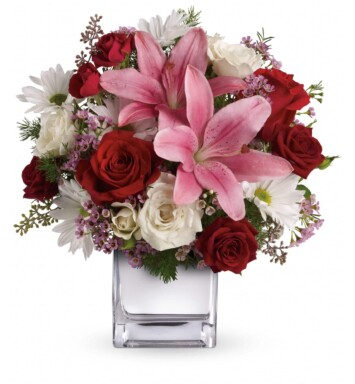 red roses and pink lilies in cube