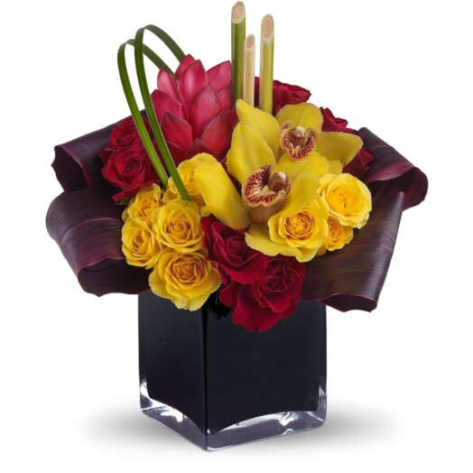 Yellow cymbidium orchids, red ginger, red and yellow spray roses