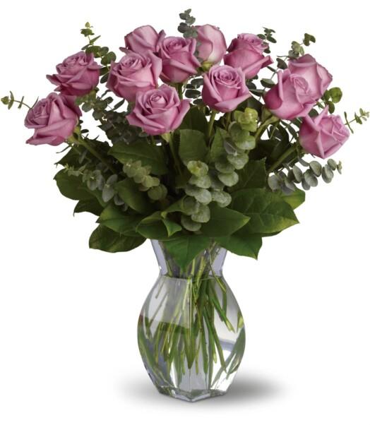 12 lavender roses in a vase