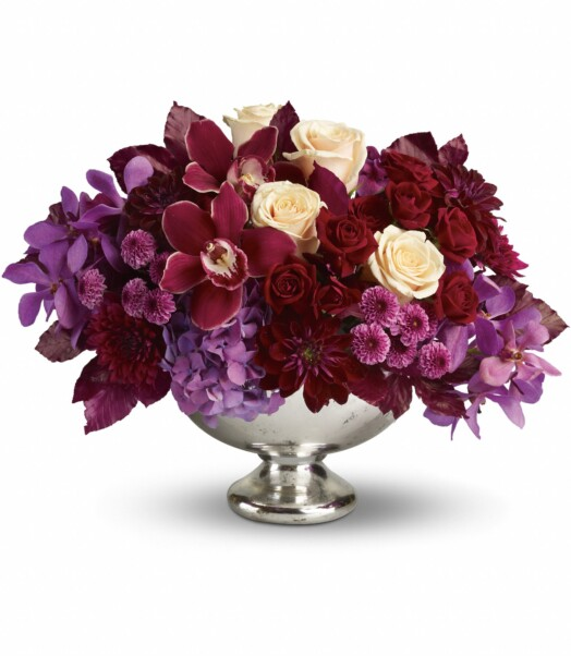 red cymbidium orchids, purple mokara orchids, lavender hydrangea, crème roses, dark red spray roses, burgundy dahlias, purple and lavender chrysanthemums