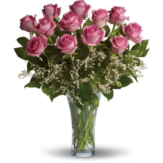 12 pink roses in a vase