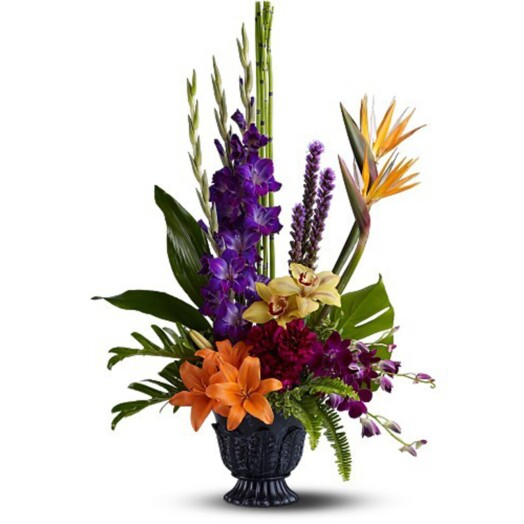 Asiatic lilies, orchids, gladioli, Birds of Paradise, Xanadu Philodendron and Aspidistra leaves