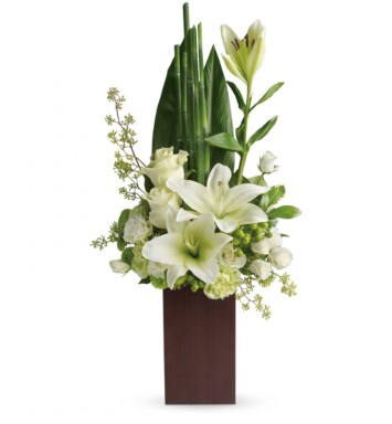 white blooms and fresh tropical greens