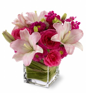 hot pink roses, pale pink lilies and mixed blossoms
